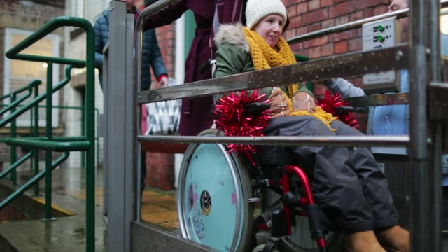 stockvideo's en b-roll-footage met met behulp van wheelchair accessible - newcastle upon tyne