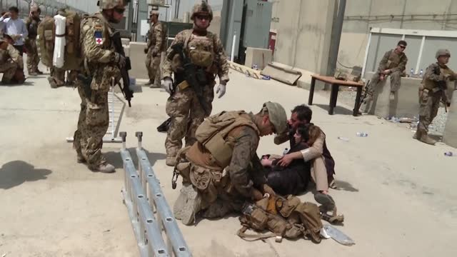 led coalition soldiers open fireinto air to disperse panicked afghans at hamid karzai international airport on august 18, 2021 in kabul, afganistan. - afghanistan stock videos & royalty-free footage