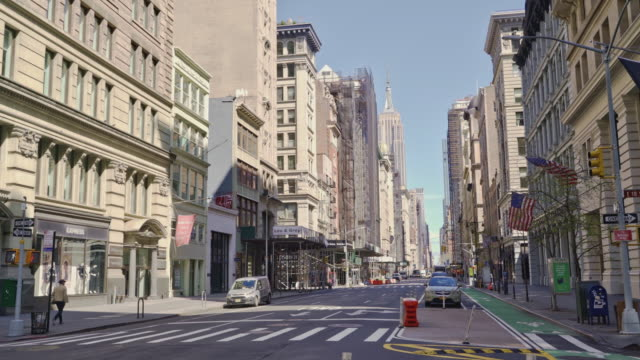 usually overcrowded, 5th avenue is deserted because of the coronavirus covid-19 pandemic. - town stock videos & royalty-free footage