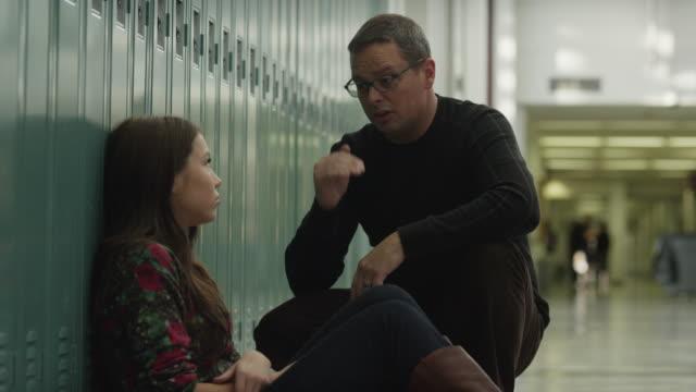 usa, utah, alpine, mature man talking with teenage girl (14-15) at school  - locker stock videos and b-roll footage