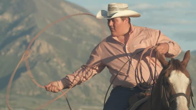 utah  cowboy with lasso - ranch icon stock videos & royalty-free footage