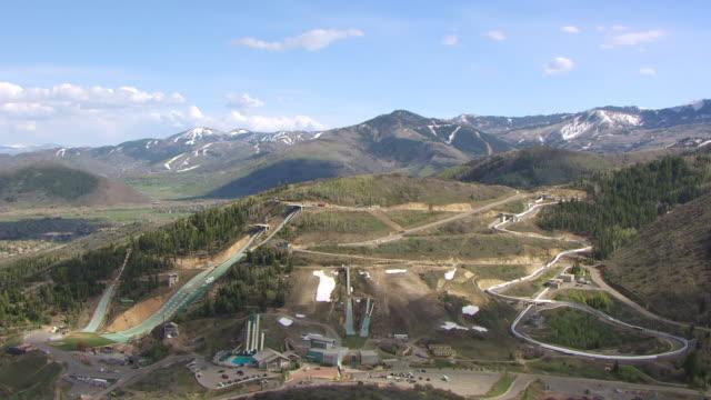 ws aerial utah olympic park with ski jumps / park city, utah, united states - park city utah stock videos and b-roll footage