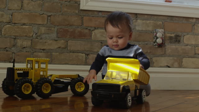 usa, utah, provo, baby boy (6-11months) with toy truck - toy stock videos & royalty-free footage