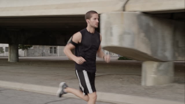usa, utah, provo, young man jogging - junger mann allein stock-videos und b-roll-filmmaterial