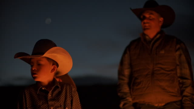utah rancher family by the bonfire - sibling stock videos & royalty-free footage