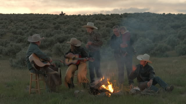 utah rancher family by the bonfire - cowboy stock videos & royalty-free footage
