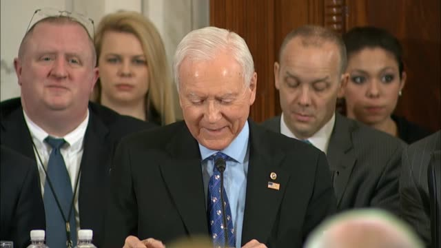 stockvideo's en b-roll-footage met utah senator orrin hatch jokes with senator jeff sessions welcoming him to the senate for his nomination hearing to be attorney general hatch and... - procureur generaal