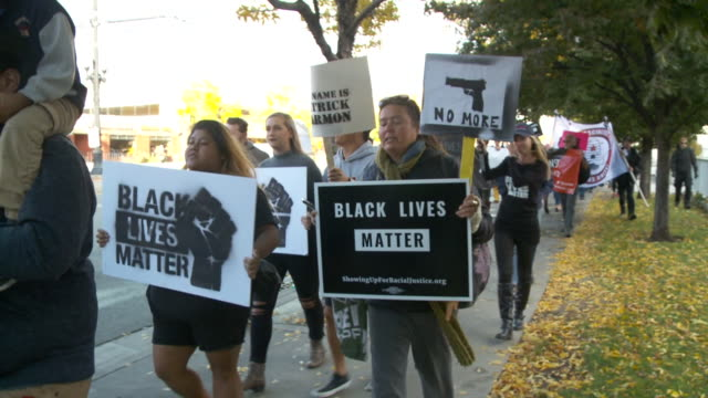 kstu utahns gathered outside the public safety building in salt lake city on oct 8 for a black lives matter rally calling for police accountability... - police brutality stock videos and b-roll footage