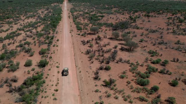ute driving on dirt country road in outback australia, aerial view - distant stock videos & royalty-free footage