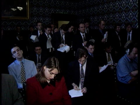 Utilities windfall Tax MS Gordon Brown and Frank Dobson into pkf and take seats with backdrop 'New Labour New Britain' GV Press standing some writing...