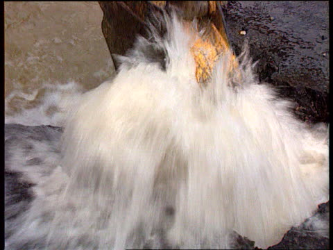 Utilities windfall Tax ITN LIB Location Unknown CMS Water gushing upwards from broken main PULL OUT as grab of digger into it MS Digger working on...