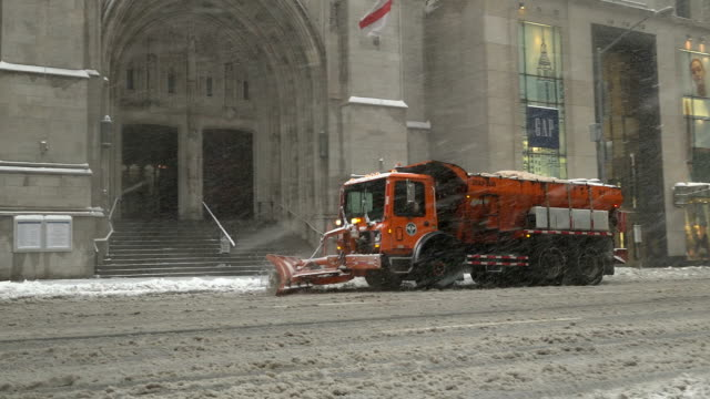 Utility snowplowing truck via 5th Avenue in the mid 50's / After a day of 60 degree Fahrenheit temperature winter storm Niko hits the Northeast of...