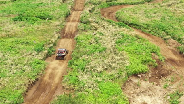 vidéos et rushes de utility vehicle (utv) riding for leisure / seogwipo-si, jeju-do, south korea - sports utility vehicle