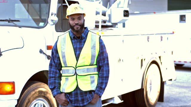 utility worker in safety vest, by truck - maintenance engineer stock videos & royalty-free footage