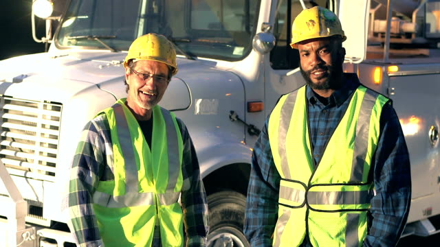 utility workers in safety vests and hardhats by truck - maintenance engineer stock videos & royalty-free footage