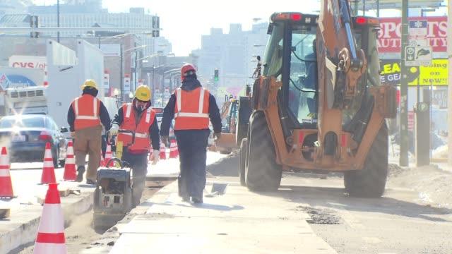 utility workers repair sidewalks during cold weather snap - maintenance engineer stock videos & royalty-free footage