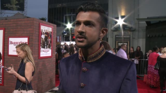 stockvideo's en b-roll-footage met interview utkarsh ambudkar on why joining this franchise was a dream come true what it was like working with some of his favorite rappers talks about... - tcl chinese theatre