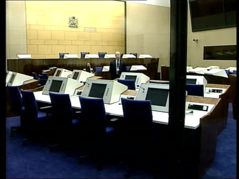 utrecht camp zeist int side lawyers standing in courtroom bv seating in court desks in court ext gv gates to compound shutting order ref t25040027 - utrecht stock videos and b-roll footage