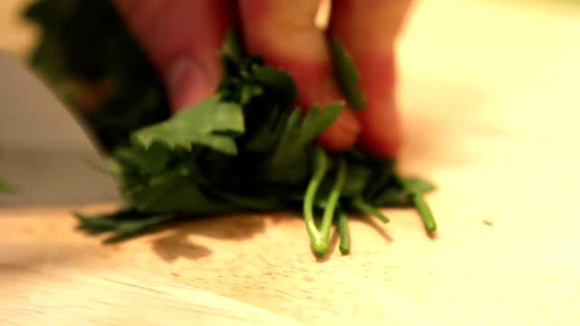 сutting fresh parsley - parsley stock videos and b-roll footage