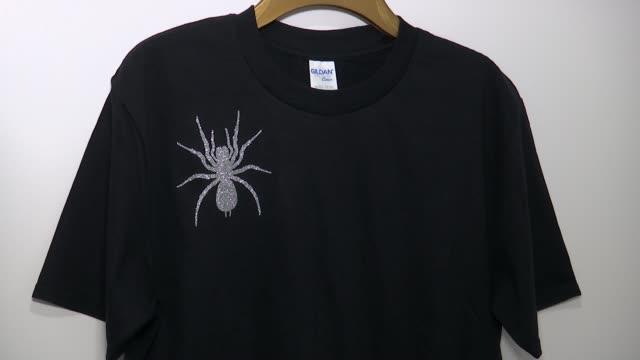 uxbridge company creates t-shirts with design based on lady hale's spider brooch; england: london: uxbridge: ext sign 'balcony' outside balcony... - black shirt stock videos & royalty-free footage
