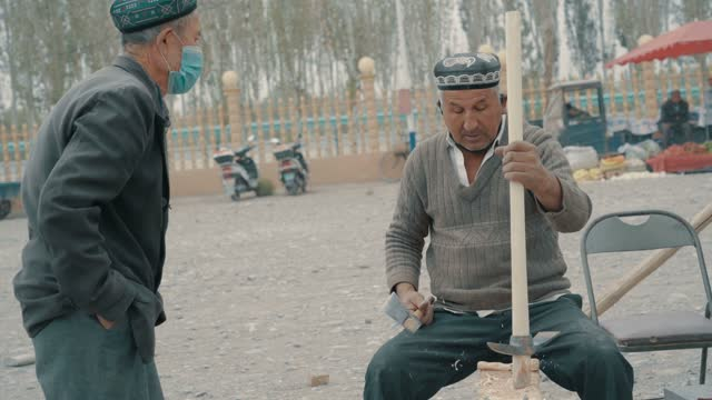 uygur craftsman in market,kashgar, xinjiang,china. - china east asia stock videos & royalty-free footage