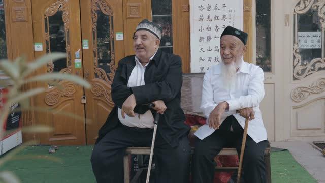 uygur elderly in kashgar old town,xinjiang,china. - tourism stock videos & royalty-free footage