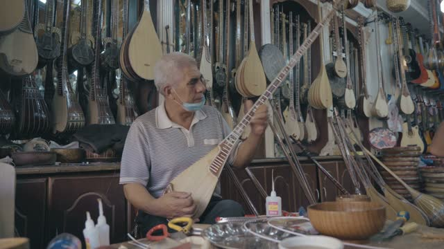 uygur traditional musical instrument store in kashgar old town,xinjiang,china. - work tool stock videos & royalty-free footage