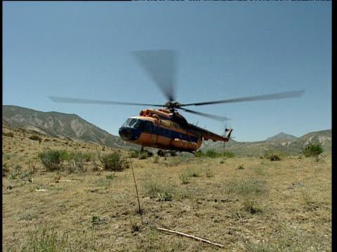 uzbek military helicopter prepares for takeoff uzbekistan - ムラがある点の映像素材/bロール