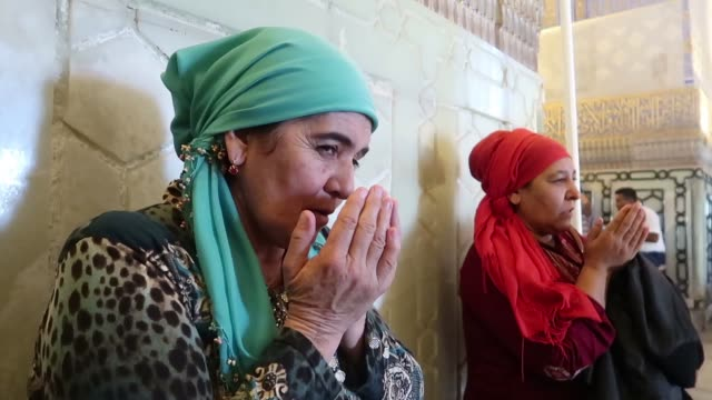 uzbek muslim women praying inside gur-i amir or guri amir mausoleum of the turco-mongol conqueror timur also known as tamerlane in the city of... - eddie gerald stock videos & royalty-free footage