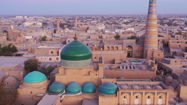 uzbekistan khiva cityscape sunset twilight aerial 4k drone flight - minaret stock videos & royalty-free footage