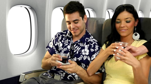 Vacation Couple Toasting On Airplane