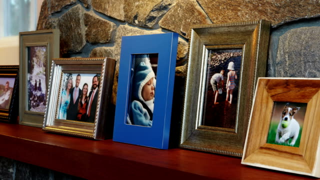 Vacation Family Photos on Mantel