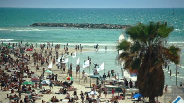 Vacationers enjoy the afternoon sun at Gordon Beach in Tel Aviv.