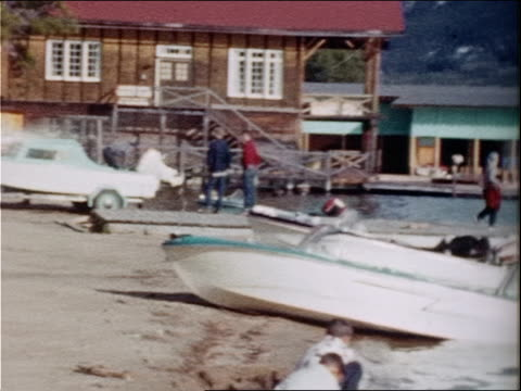 vacationers sit in boats and walk on docks at grand lake, colorado. - urlaubsort stock-videos und b-roll-filmmaterial
