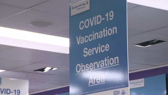 "vaccination waiting area and signs in superdrug pharmacy in guildford - ""bbc news"" stock videos & royalty-free footage"