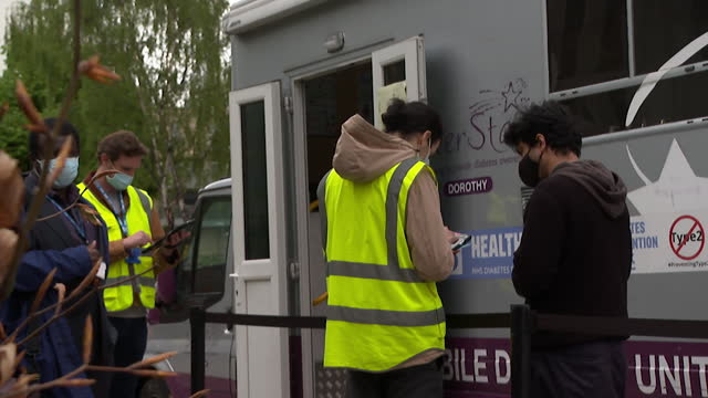 vaccine bus in brent, london, where no prior appointments are needed, getting to communities where take up is low - commercial land vehicle stock videos & royalty-free footage