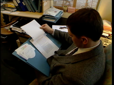 public reassurance lib royal free hospital seq dr andrew wakefield removing notes from shelf then sitting reading at desk dr andrew wakefield... - mmr stock videos and b-roll footage