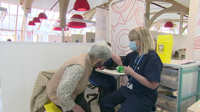 "vaccines given at vaccination centre in norwich's castle quarter - ""bbc news"" stock videos & royalty-free footage"