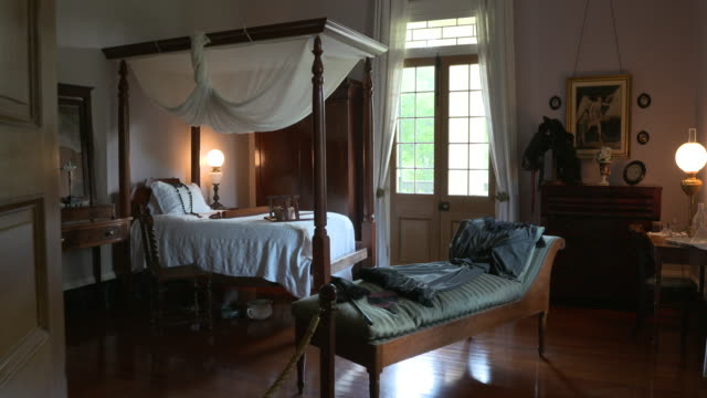 vacherie, u.s., interiors of oak alley plantation mansion, on friday, may 19, 2017. - bed furniture stock videos & royalty-free footage