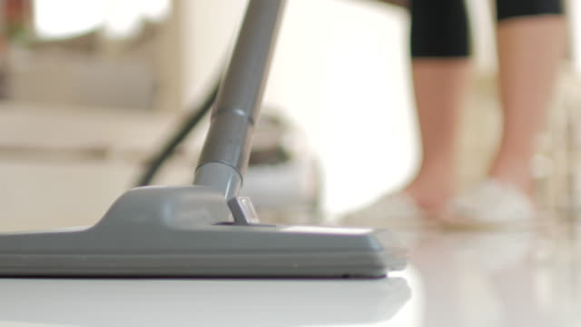 Vacuum cleaner cleaning on the ground , 4k(UHD)
