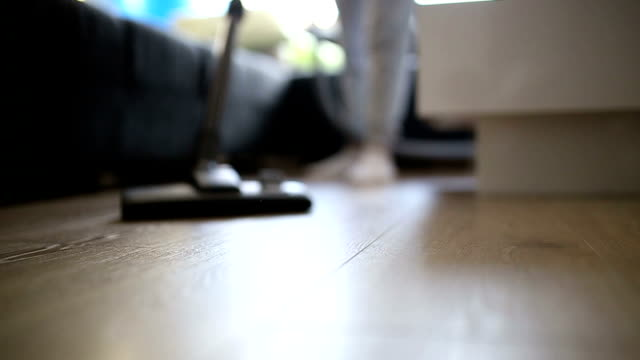 vacuum cleaner cleaning on the ground - home decor stock videos & royalty-free footage