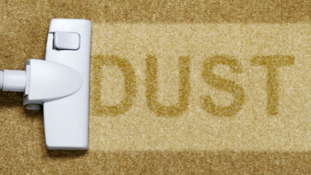 vacuum cleaning carpet showing text dust