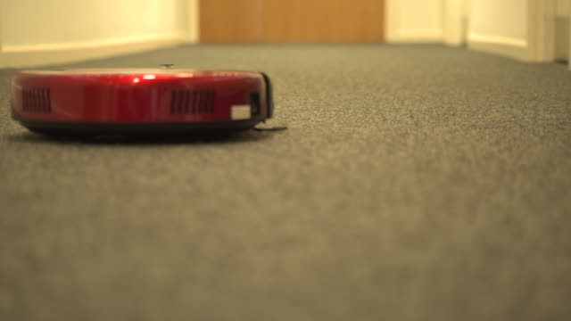 vacuum moving away from camera - vacuum cleaner stock videos & royalty-free footage