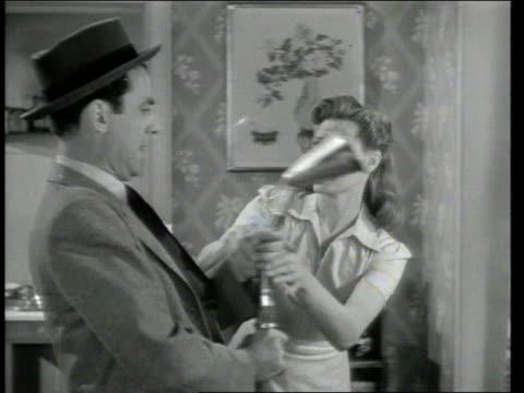 1947 montage a vacuum salesman visiting a home - saugen mund benutzen stock-videos und b-roll-filmmaterial