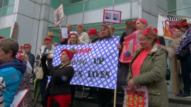 protest about lack of care for women harmed by implants; england: london: ext various of people protesting at the delay in treatment for women harmed... - 生殖器点の映像素材/bロール