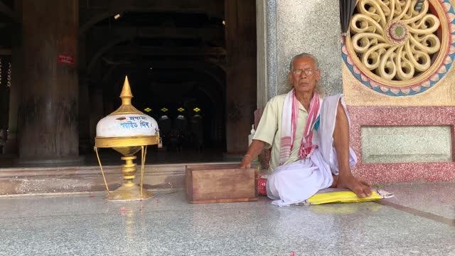 vaishnava priest sitting at barpeta sattra namghar on august 30, 2021 in barpeta, india. barpeta satra is an important place of worship in assam, sri... - senior men stock videos & royalty-free footage