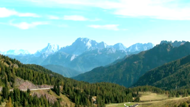 val di fassa, panoramic view of a mountain range. - val di fassa stock videos and b-roll footage