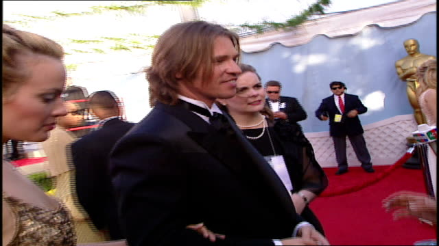 val kilmer talking to various reporters on the red carpet - 71st annual academy awards stock videos & royalty-free footage