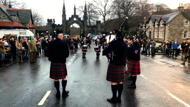 vale of atholl pipe band play at the traditional opening of the river tay salmon season on january 15, 2018 in kenmore, scotland. the traditional... - bagpipes stock videos & royalty-free footage