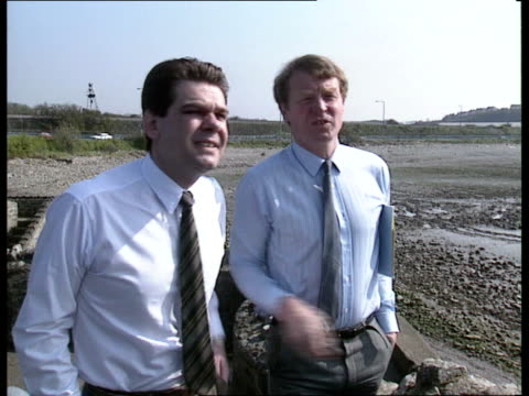 Vale of Glamorgan byelection Preview **** FOR South Wales Barry Polluted beach Labour candidate John Smith walking along beach near power station...